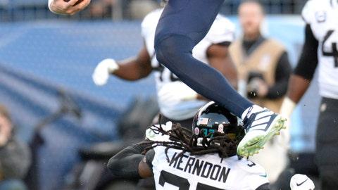 <p>               Tennessee Titans quarterback Ryan Tannehill (17) jumps over Jacksonville Jaguars cornerback Tre Herndon (37) as Tannehil scores a touchdown on a 21-yard run in the first half of an NFL football game Sunday, Nov. 24, 2019, in Nashville, Tenn. (AP Photo/Mark Zaleski)             </p>