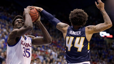 <p>               UNC Greensboro's Kaleb Hunter (44) tries to block a shot by Kansas' Udoka Azubuike (35) during the first half of an NCAA college basketball game Friday, Nov. 8, 2019, in Lawrence, Kan. (AP Photo/Charlie Riedel)             </p>