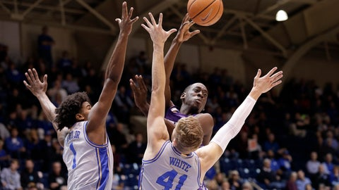 <p>               Central Arkansas guard Collin Cooper passes as Duke center Vernon Carey Jr. (1) and forward Jack White (41) guard during the half of an NCAA college basketball game in Durham, N.C., Tuesday, Nov. 12, 2019. (AP Photo/Gerry Broome)             </p>