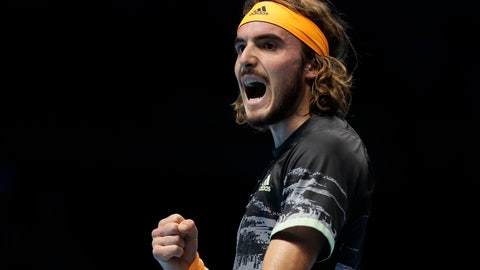 <p>               Stefanos Tsitsipas of Greece celebrates winning a point against Roger Federer of Switzerland during their ATP World Tour Finals semifinal tennis match at the O2 Arena in London, Saturday, Nov. 16, 2019. (AP Photo/Kirsty Wigglesworth)             </p>
