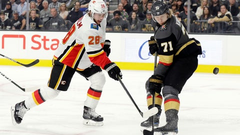 <p>               Vegas Golden Knights center William Karlsson (71) defends as Calgary Flames center Elias Lindholm (28) shoots during the first period of an NHL hockey game Sunday, Nov. 17, 2019, in Las Vegas. (AP Photo/Isaac Brekken)             </p>