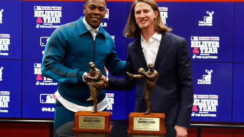 <p>               Milwaukee Brewers Josh Hader, right, and New York Yankees Aroldis Chapman pose with their reliever of the year trophies at a news conference before Game 4 of the baseball World Series between the Houston Astros and the Washington Nationals Saturday, Oct. 26, 2019, in Washington. (AP Photo/Patrick Semansky)             </p>