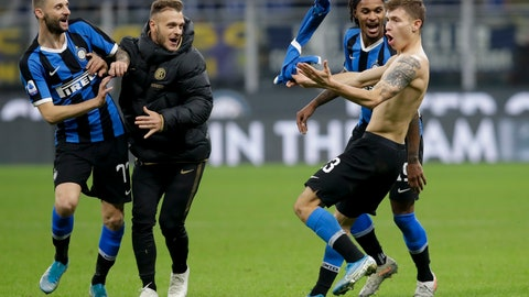 <p>               Inter Milan's Nicolo Barella, right, celebrates after scoring his side's second goal during the Serie A soccer match between Inter Milan and Hellas Verona, at the San Siro stadium in Milan, Italy, Saturday, Nov. 9, 2019. (AP Photo/Luca Bruno)             </p>