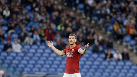 <p>               Roma's Edin Dzeko talks to fans as the match was briefly suspended because fans were making racist chants against Napoli's Kalidou Koulibaly, during an Italian Serie A soccer match between Roma and Napoli, at the Olympic stadium in Rome, Saturday, Nov. 2, 2019. (AP Photo/Gregorio Borgia)             </p>