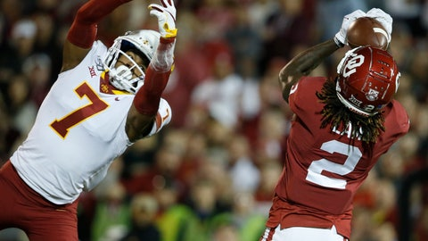 <p>               Oklahoma wide receiver CeeDee Lamb (2) catches a touchdown pass in front of Iowa State defensive back Justin Bickham (7) during the first quarter of an NCAA college football game in Norman, Okla., Saturday, Nov. 9, 2019. (AP Photo/Sue Ogrocki)             </p>