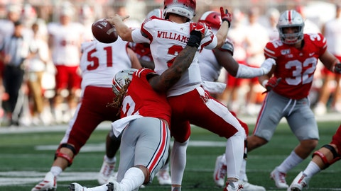 """<p>               FILE - In this Sept. 21, 2019, file photo, Ohio State defensive end Chase Young, left, sacks Miami (Ohio) quarterback Jackson Williamson causing a fumble during the first half of an NCAA college football game, in Columbus, Ohio. Ohio State says defensive end Chase Young won't play Saturday against Maryland because of a possible NCAA """"issue"""" in 2018. The surprising news was announced by the school with team's status report and depth chart for the coming game. The statement says Young is being held out because of a """"possible NCAA issue from last year"""" the athletic department is """"looking into."""" (AP Photo/Jay LaPrete, File)             </p>"""