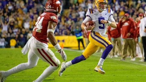 <p>               LSU quarterback Joe Burrow (9) runs for a first down, near Arkansas defensive back LaDarrius Bishop (24) during the first half of an NCAA college football game in Baton Rouge, La., Saturday, Nov. 23, 2019. (AP Photo/Matthew Hinton)             </p>