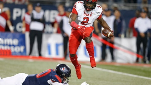 <p>               Utah running back Zack Moss (2) avoids the tackle attempt by Arizona defensive lineman Trevon Mason during the first half during an NCAA college football game Saturday, Nov. 23, 2019, in Tucson, Ariz. (AP Photo/Rick Scuteri)             </p>
