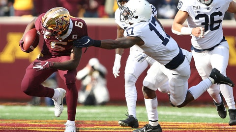 <p>               Minnesota wide receiver Tyler Johnson (6) escapes a tackle from Penn State safety Garrett Taylor (17) during an NCAA college football game, Saturday, Nov. 9, 2019, in Minneapolis. (AP Photo/Stacy Bengs)             </p>