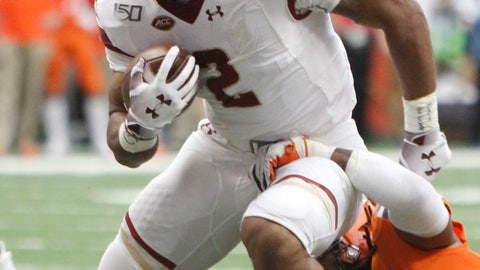 <p>               Boston's College's AJ Dillon, left, breaks a tackle by Syracuse's Lakiem Williams during the first quarter of an NCAA college football game in Syracuse, N.Y., Saturday, Nov. 2, 2019. (AP Photo/Nick Lisi)             </p>