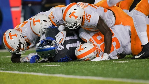 <p>               Kentucky running back Asim Rose (10) is tackled by several Tennessee defenders during the second half of an NCAA college football game Saturday, Nov. 9, 2019, in Lexington, Ky. (AP Photo/Bryan Woolston)             </p>