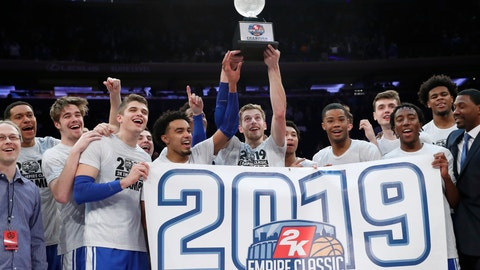 <p>               Duke players celebrate with the trophy after defeating Georgetown 81-73 in an NCAA college basketball game for the 2K Empire Classic championship, Friday, Nov. 22, 2019 in New York. (AP Photo/Kathy Willens)             </p>