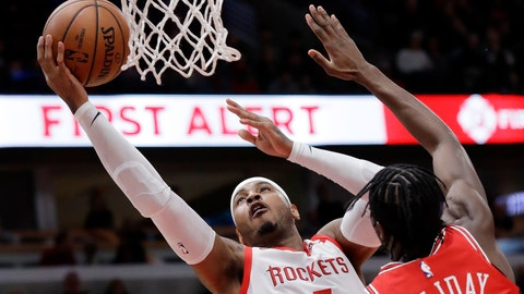 <p>               FILE - In this Nov. 3, 2018, file photo, Houston Rockets forward Carmelo Anthony, left, drives to the basket against Chicago Bulls forward Justin Holiday during the first half of an NBA basketball game in Chicago. A person familiar with the details says Anthony is returning to the NBA with the Portland Trail Blazers. The 10-time All-Star has not played since a short stint with the Rockets ended a little more than a year ago after just 10 games. (AP Photo/Nam Y. Huh, File)             </p>