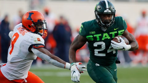 <p>               Michigan State running back Elijah Collins (24) pulls away from Illinois linebacker Dele Harding (9) for a touchdown during the first half of an NCAA college football game, Saturday, Nov. 9, 2019, in East Lansing, Mich. (AP Photo/Carlos Osorio)             </p>