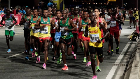 <p>               FILE - In this Oct. 6, 2019, file photo, athletes compete during the men's marathon at the World Athletics Championships in Doha, Qatar. Lelisa Desisa, of Ethiopia, won the race. The IOC is seeking to relocate next summer's Olympic marathon from steamy Tokyo to the cooler northern city of Sapporo after seeing competitors collapse in extreme heat at the world championships in Qatar.  (AP Photo/Nariman El-Mofty, File)             </p>