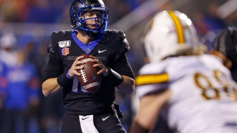 <p>               Boise State quarterback Chase Cord, left, looks down field against Wyoming during the second half of an NCAA college football game Saturday, Nov. 9, 2019, in Boise, Idaho. Boise State won 20-17. (AP Photo/Steve Conner)             </p>
