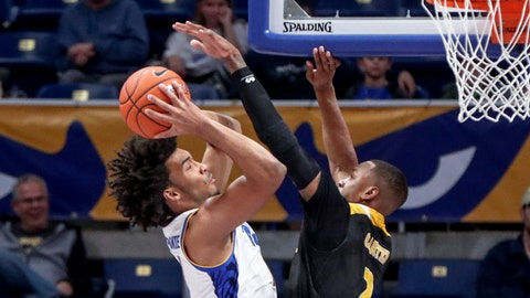 <p>               Pittsburgh's Justin Champagnie, left, shots as Arkansas-Pine Bluff's Marquell Carter (2) defends during the first half of an NCAA college basketball game Thursday, Nov. 21, 2019, in Pittsburgh. (AP Photo/Keith Srakocic)             </p>