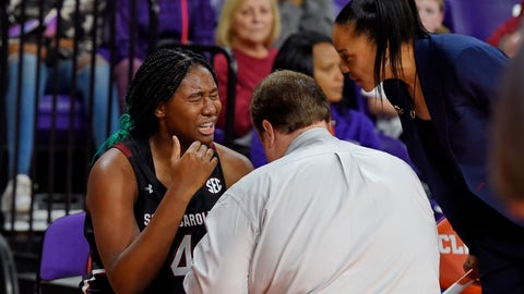 <p>               South Carolina head coach Dawn Staley, right, checks on Aliyah Boston while a trainer tends to Boston after an injury during the first half of an NCAA college basketball game against Clemson, Sunday, Nov. 24, 2019, in Clemson, S.C. (AP Photo/Richard Shiro)             </p>