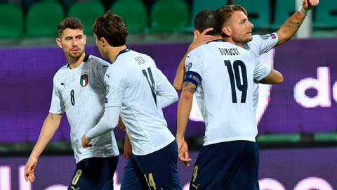 <p>               Italy's Ciro Immobile, right, celebrates with teammates after scoring his side's first goal during a group J qualifying soccer match between Italy and Armenia at the Renzo Barbera stadium, in Palermo, Italy, Monday, Nov. 18, 2019. (ANSA via AP)             </p>