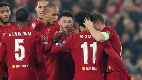 <p>               Liverpool's Alex Oxlade-Chamberlain, 3rd right, celebrates after scoring his side's second goal during the Champions League group E soccer match between Liverpool and Genk at Anfield Stadium, Liverpool, England, Tuesday, Nov. 5, 2019. (AP Photo/Jon Super)             </p>