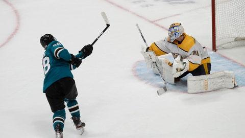 <p>               San Jose Sharks right wing Timo Meier, left, scores against Nashville Predators goaltender Juuse Saros (74) in the shootout of an NHL hockey game in San Jose, Calif., Saturday, Nov. 9, 2019. The Sharks won 2-1. (AP Photo/Jeff Chiu)             </p>