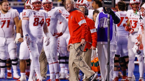 <p>               FILE - In this Saturday, Nov. 16, 2019, file photo, New Mexico head coach Bob Davie, center, reacts to a call against Boise State during the first half of an NCAA college football game in Boise, Idaho. On Monday, Nov. 25, Davie agreed to step aside as New Mexico's coach at the end of the season, ending an uneven eight-season tenure with the Lobos. (AP Photo/Steve Conner, File)             </p>