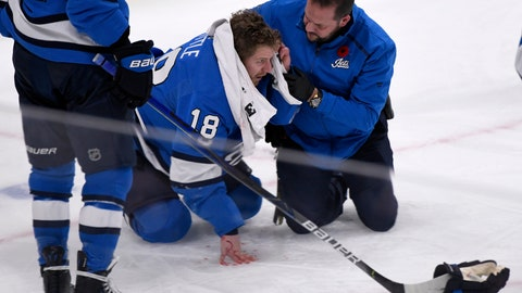 <p>               Winnipeg Jets' Bryan Little (18) is helped after getting hit in the head with the puck against the New Jersey Devils during the third period of an NHL hockey game, Tuesday, Nov. 5, 2019 in Winnipeg, Manitoba. (Fred Greenslade/Canadian Press via AP)             </p>