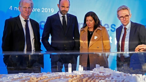 <p>               FILE - In this Monday Nov. 4, 2019 file photo, French Prime Minister Edouard Philippe, second left, and Mayor of Paris Anne Hidalgo look at an architectural model as they attend a ceremony to mark the start of the construction of Paris 2024 Olympic Village in Saint-Ouen, near Paris. A partnership deal signed by the IOC with Airbnb has sparked the ire of French hoteliers, who have suspended their collaboration with Paris 2024 Olympics organizers over fears the agreement sealed with the platform will create unfair competition. (Gonzalo Fuentes, Pool via AP, File)             </p>