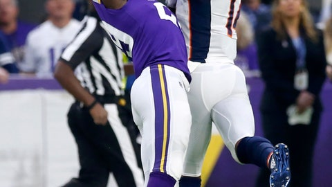 <p>               Denver Broncos wide receiver Courtland Sutton, right, catches a pass over Minnesota Vikings cornerback Xavier Rhodes, left, during the first half of an NFL football game, Sunday, Nov. 17, 2019, in Minneapolis. (AP Photo/Jim Mone)             </p>