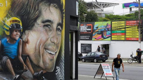 <p>               In this Nov. 7, 2019 photo, a mural depicts legendary Brazilian F1 driver Ayrton Senna on a business front near the Interlagos racetrack in Sao Paulo, Brazil. Many bars on busy streets like Avenida Paulista are open 24 hours a day during the Brazil F1 GP race, and hotels prepare feasts at early hours so fans don't need to refuel at the track. (AP Photo/Nelson Antoine)             </p>