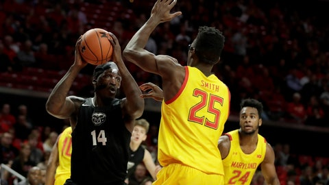 <p>               Oakland forward Xavier Hill-Mais (14) goes up for a shot against Maryland forward Jalen Smith (25) during the first half of an NCAA college basketball game, Saturday, Nov. 16, 2019, in College Park, Md. (AP Photo/Julio Cortez)             </p>