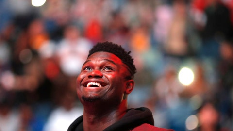 <p>               New Orleans Pelicans forward Zion Williamson watches the video screen during a player introduction video before the team's NBA basketball game against the Denver Nuggets in New Orleans, Thursday, Oct. 31, 2019. The rookie first-round draft pick is recovering from knee surgery. (AP Photo/Gerald Herbert)             </p>