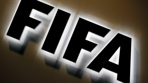 """<p>               FILE - This Sept. 25, 2015 file photo shows the FIFA logo outside FIFA headquarters in Zurich, Switzerland. FIFA has told soccer's biggest agents who are resisting limits to their cut of deals that there is a necessity to """"curb the excesses"""" of the $7 billion annual transfer market. Agent earnings from transfers would be capped at a maximum 10% of fees when acting for the selling club under changes set to be introduced from 2021. (AP Photo/Michael Probst, file)             </p>"""