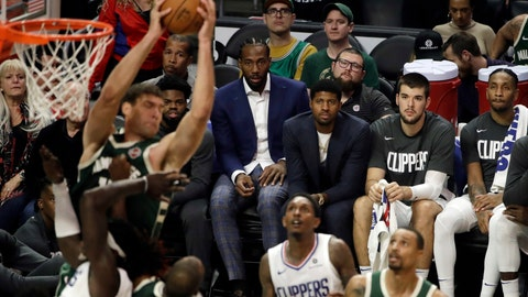 <p>               Los Angeles Clippers' Kawhi Leonard, center, and Paul George, third from right, watch from the bench during the second half of the team's NBA basketball game against the Milwaukee Bucks on Wednesday, Nov. 6, 2019, in Los Angeles. (AP Photo/Marcio Jose Sanchez)             </p>