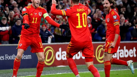 <p>               Wales' Aaron Ramsey celebrates scoring his side's first goal of the game against Hungary, with team-mates Gareth Bale, left, and Joe Allen, right, during  their UEFA Euro 2020 Qualifying soccer match at the Cardiff City Stadium, in Cardiff, Wales, Tuesday Nov. 19, 2019. (Nick Potts/PA via AP)             </p>