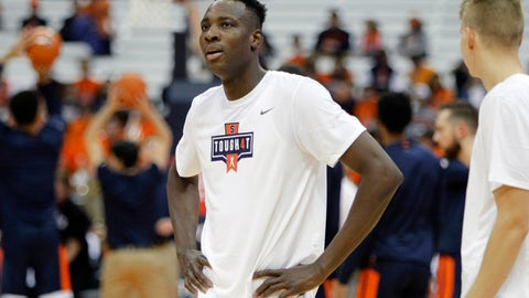 <p>               Syracuse's Bourama Sidibe wears a shirt in support of Syracuse women's basketball player Tiana Mangakahia who has announced her cancer diagnosis in Syracuse, N.Y., Wednesday, Nov. 6, 2019. Syracuse players wore the shirts during warm ups before an NCAA college basketball game against Virginia. (AP Photo/Nick Lisi)             </p>