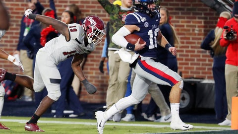 <p>               Mississippi quarterback John Rhys Plumlee (10) outruns New Mexico State defensive back Austin Perkins (19) on his way to a 18-yard touchdown run during the second half of an NCAA college football game in Oxford, Miss., Saturday, Nov. 9, 2019. (AP Photo/Rogelio V. Solis)             </p>