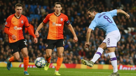 <p>               Manchester City's Ilkay Gundogan, right, scores his side's first goal during the group C Champions League soccer match between Manchester City and Shakhtar Donetsk at the Etihad Stadium in Manchester, England, Tuesday, Nov. 26, 2019. (AP Photo/Dave Thompson)             </p>