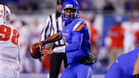 <p>               Boise State quarterback Jaylon Henderson (9) looks down field against New Mexico during the second half of an NCAA college football game Saturday, Nov. 16, 2019, in Boise, Idaho. Boise State won 42-9. (AP Photo/Steve Conner)             </p>