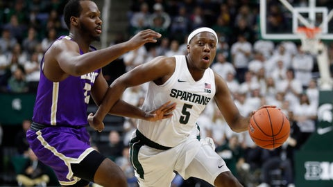 <p>               Michigan State guard Cassius Winston (5) drives on Albion forward Quinton Armstrong during the second half of an NCAA college exhibition basketball game, Tuesday, Oct. 29, 2019, in East Lansing, Mich. (AP Photo/Carlos Osorio)             </p>