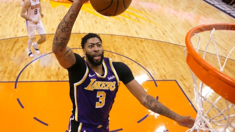 <p>               Los Angeles Lakers forward Anthony Davis scores against the Phoenix Suns during the second half during an NBA basketball game Tuesday, Nov. 12, 2019, in Phoenix. (AP Photo/Rick Scuteri)             </p>