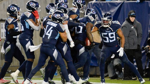 <p>               Tennessee Titans inside linebacker Wesley Woodyard (59) celebrates after linebacker Daren Bates (53) recovered a Jacksonville Jaguars' fumble in the second half of an NFL football game Sunday, Nov. 24, 2019, in Nashville, Tenn. (AP Photo/Mark Zaleski)             </p>