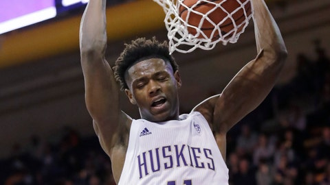 <p>               Washington's Nahziah Carter dunks against Maine during the second half of an NCAA college basketball game Tuesday, Nov. 19, 2019, in Seattle. (AP Photo/Elaine Thompson)             </p>