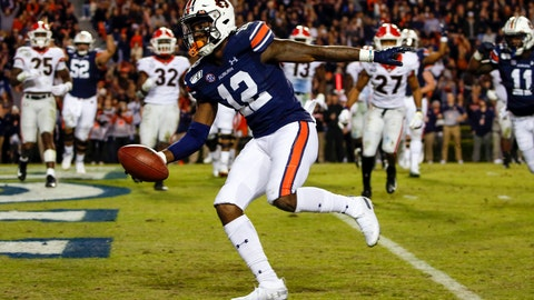 <p>               Auburn wide receiver Eli Stove (12) scores a touchdown during the second half of an NCAA college football game against Georgia, Saturday, Nov. 16, 2019, in Auburn, Ala. (AP Photo/Butch Dill)             </p>