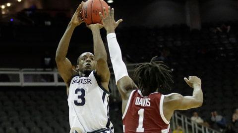 <p>               Butler guard Kamar Baldwin (3) shoots over Stanford guard Daejon Davis (1) to score the winning basket during an NCAA college basketball game Tuesday, Nov. 26, 2019, in Kansas City, Mo. Butler won 68-67. (AP Photo/Charlie Riedel)             </p>