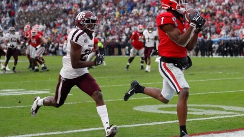 <p>               Georgia wide receiver George Pickens (1) makes a catch for a touchdown as Texas A&M defensive back Debione Renfro (29) defends in the first half of an NCAA college football game Saturday, Nov. 23, 2019, in Athens, Ga. (AP Photo/John Bazemore)             </p>