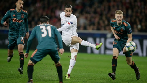 <p>               Lille's Yusuf Yazici, 2nd right, kicks the ball while Ajax's Noussair Mazraoui, left, Ajax's Nicolas Tagliafico, 2nd left, and Ajax's Perr Schuurs looks on during the group H Champions League soccer match between LOSC Lille and Ajax at the Stade Pierre Mauroy - Villeneuve d'Ascq stadium in Lille, France, Wednesday, Nov. 27, 2019. (AP Photo/Michel Spingler)             </p>