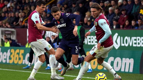 <p>               West Ham United's Aaron Cresswell, centre and Burnley's Jeff Hendrick, right, battle for the ball during the English Premier League soccer match between Burnley and West Ham United, at Turf Moor, in Burnley, England,  Saturday, Nov.  9, 2019. (Ian Hodgson/PA via AP)             </p>