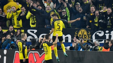 <p>               Dortmund's Achraf Hakimi, top, celebrates with his teammates after scoring his side's third goal during the Champions League group F soccer match between Borussia Dortmund and Inter Milan, in Dortmund, Germany, Tuesday, Nov. 5, 2019. (AP Photo/Martin Meissner)             </p>