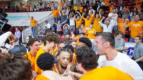 <p>               Tennessee players swarm guard Lamonte Turner, center, after hitting the game-winning shot at the buzzer against Virginia Commonwealth in an NCAA college basketball game in the Emerald Coast Classic in Niceville, Fla., Saturday, Nov. 30, 2019. Tennessee won 72-69. (AP Photo/Mark Wallheiser)             </p>
